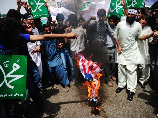 Demonstrators torch a US flag during a protest against an anti-Islam film in Karachi on September 20, 2012. PHOTO: AFP/FILE