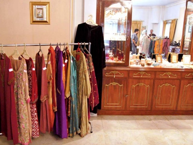 7d96d82e25 People examine the various dresses on display at the exhibition. PHOTO  THE  EXPRESS TRIBUNE