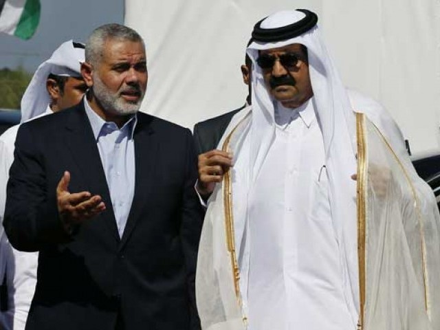Hamas prime minister Ismail Haniya and the Emir of Qatar Sheikh Hamad bin Khalifa al-Thani arrive to a cornerstone laying ceremony for Hamad, a new residential neighbourhood in Khan Yunis in the southern Gaza Strip on October 23, 2012. PHOTO: AFP
