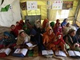internally-displaced-girls-fleeing-a-military-offensive-in-the-swat-valley-hold-classes-inside-a-tent-at-an-unhcr-camp-in-the-outskirts-of-peshawar-2