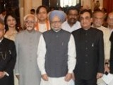 Indian President Pranab Mukherjee (5L) and Prime Minister Manmohan Singh (7L) pose with India's new ministers after a swearing-in ceremony at The Presidental Palace in New Delhi on October 28, 2012.