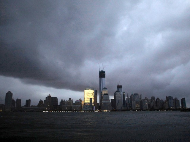 The Manhattan skyline in darkness after a preventive power outage caused by giant storm Sandy in New York. PHOTO: REUTERS