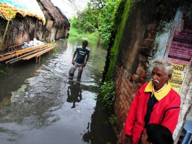 Downpours triggered by a cyclone that hit the coast near Chennai left hundreds of villages inundate. PHOTO: AFP/FILE