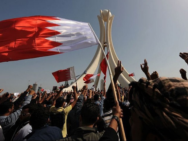 Bahraini protesters wave their national flag. PHOTO: AFP/FILE