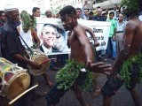 Cheerful activists in Karachi congratulate US President Barack Obama on his re-election.  PHOTO: AFP