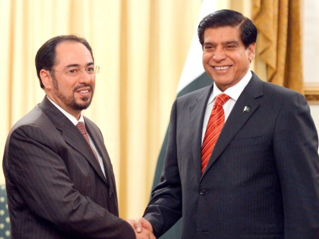 Prime Minister Raja Pervez Ashraf and chair of the Afghan High Peace Council, Salahuddin Rabbani prior to their talks in Islamabad. PHOTO: AFP