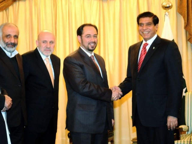 Prime Minister Raja Pervez Ashraf greets chairman of the Afghan peace council Salahuddin Rabbani on Monday. PHOTO: SANA