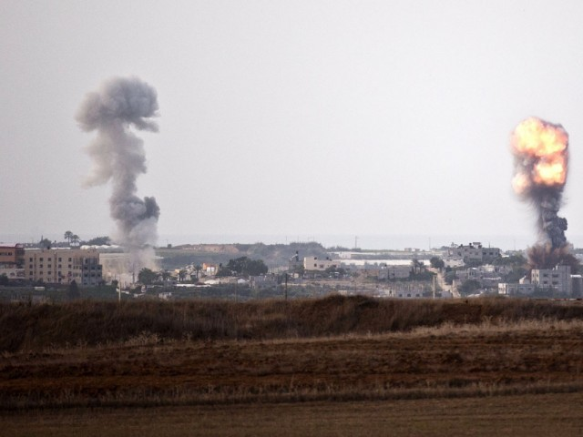 A picture taken from the southern Israeli Gaza border shows smoke billowing from spots targeted by Israeli air strike inside the Gaza strip. PHOTO: AFP