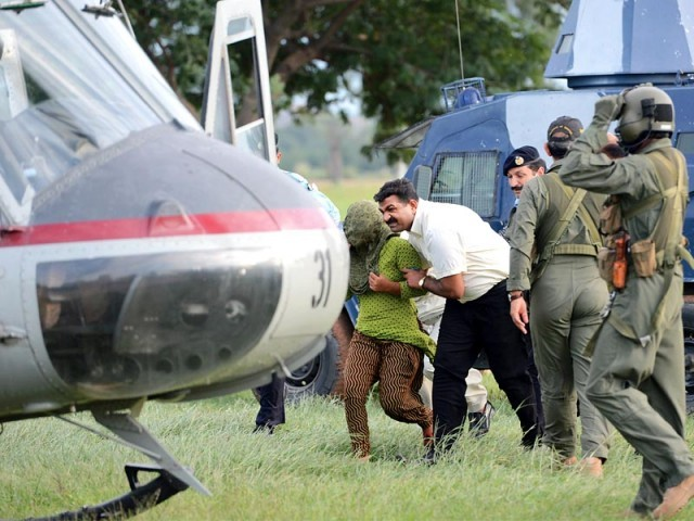 File photo of Rimsha Masih being transferred to an undisclosed location via helicopter after she was released from jail. PHOTO: AFP/ FILE