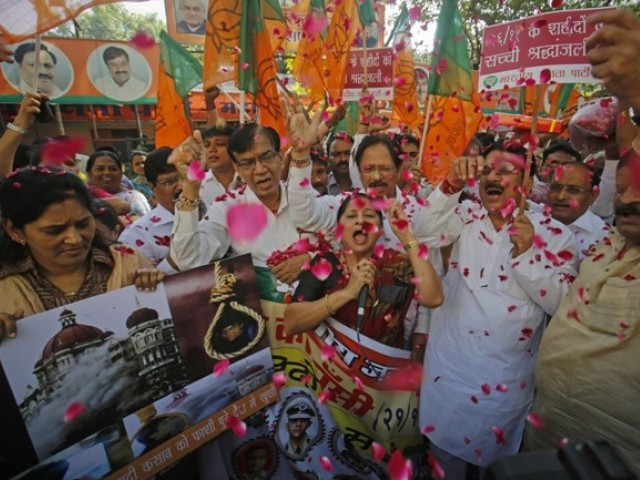 Members of India's main opposition Hindu nationalist Bharatiya Janata Party (BJP) celebrate after India hanged Mohammad Ajmal Kasab in Mumbai November 21, 2012. PHOTO: REUTERS