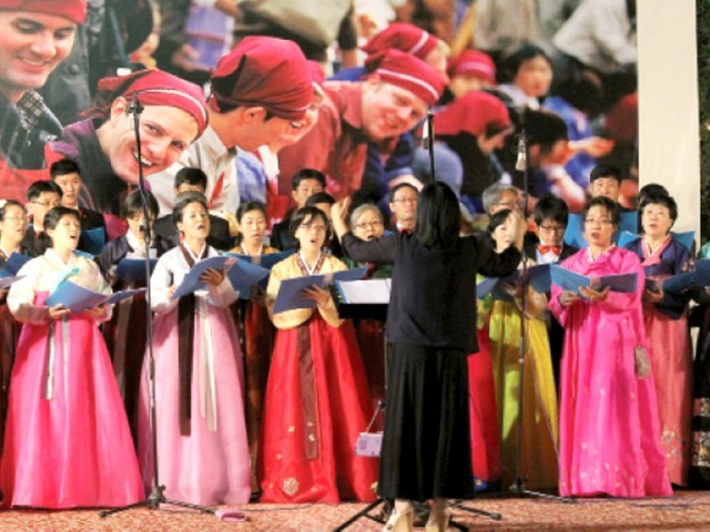 The Korean Consulate hosted a food festival on Thursday to celebrate 30 years of Pak-Korea relations. This choir sang both English and Korean songs. PHOTO: AYESHA MIR/EXPRESS