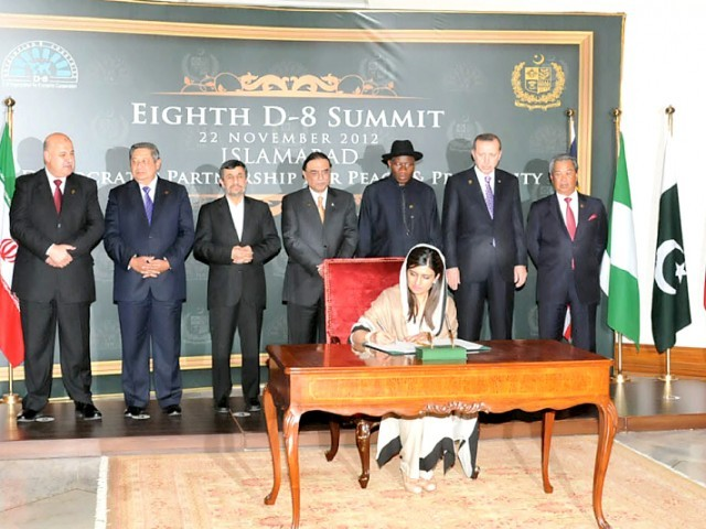 President Zardari and leaders of D-8 countries witness the signing of the D-8 Charter in Islamabad. PHOTO: NNI