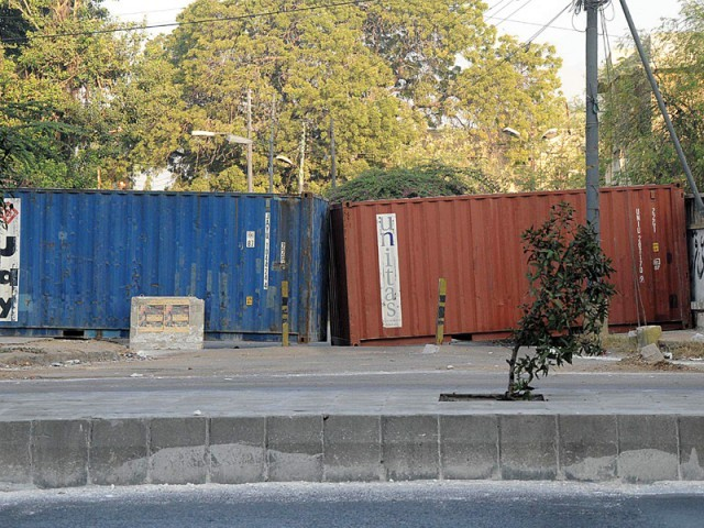 Karachi Goods Carriers Association complained that the police borrowed their containers for security but never compensated them if there were any damages. PHOTO: EXPRESS