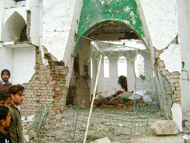 The damaged exterior of the shrine of Sufi saint Ali Mardan Shah which was bombed by militants on Saturday. PHOTO: EXPRESS