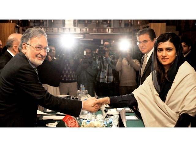 Foreign Minister Hina Rabbani Khar seals the deal with her Afghan counterpart Dr Zalmai Rassoul in Islamabad. PHOTO: AFP