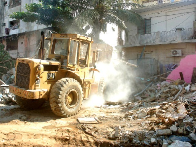Around three or four houses and a century-old temple, the Shri Rama Pir Mandir, were demolished by a private builder. PHOTO: EXPRESS/FILE
