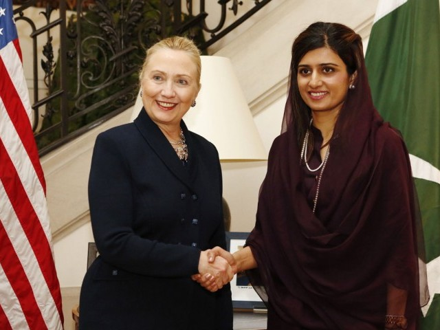 Pakistan foreign minister Hina Rabbani Khar (R) shakes hands with US Secretary of State Hillary Clinton (L) prior to their meeting in Brussels. PHOTO: AFP