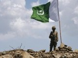 a-pakistani-soldier-poses-for-a-photo-under-pakistans-national-flag-planted-atop-the-baine-baba-ziarat-mountain-in-swat-district-2-2-2-2-2-3-2-2-2-2-2-2-2-2-2-2