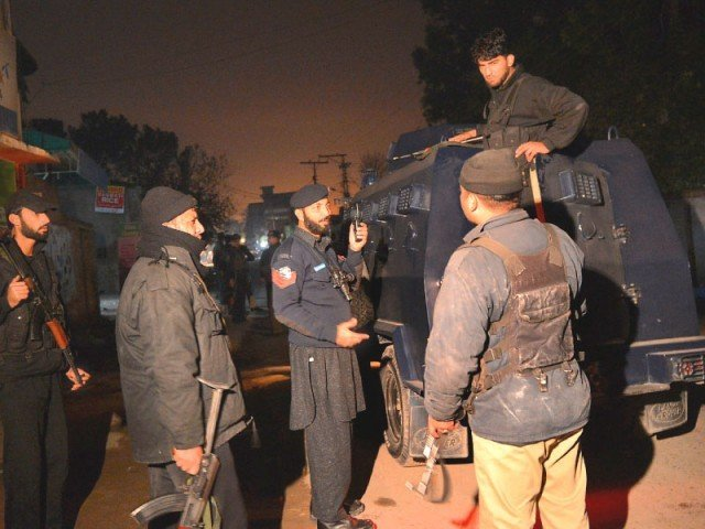 Security personnel gather near Peshawar airport following the attack. PHOTO: AFP