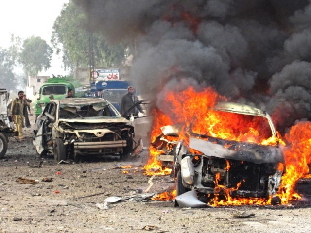 Several vehicles were destroyed in Monday's blast in Jamrud's bazaar . PHOTO: EXPRESS