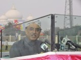 Pakistan's President Asif Ali Zardari, widower of assassinated former Prime Minister Benazir Bhutto, speaks outside the Bhutto family mausoleum to mark her death anniversary in Garhi Khuda Bakhsh, near Larkana December 26, 2012.  PHOTO : REUTERS