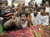 A Pakistan Peoples Party (PPP) supporter shouts slogans against the assassination of Pakistan's former Prime Minister Benazir Bhutto beside her grave during her death anniversary at the Bhutto family mausoleum in Garhi Khuda Bakhsh, near Larkana December December 27, 2012. PHOTO : REUTERS
