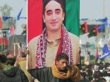 A Pakistani supporter carries a portrait of Bilawal Bhutto Zardari, chairman of ruling Pakistan People's Party (PPP) outside the Bhutto family mausoleum in Garhi Dera Bakhsh on December 27, 2012, on the fifth anniversary of the assassination of Benazir Bhutto.  PHOTO : AFP