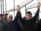 Pakistan's President Asif Ali Zardari (L) widower of assassinated former premier Benazir Bhutto, waves with his son and chairman of ruling Pakistan People's Party (PPP) Bilawal Bhutto (R) to supporters outside the Bhutto family mausoleum in Garhi Khuda Bakhsh on December 27, 2012, on the fifth anniversary of the assassination of Benazir Bhutto.  PHOTO : AFP