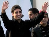 Bilawal Bhutto, son of assassinated former Pakistani premier Benazir Bhutto, and chairman of ruling Pakistan People's Party (PPP) waves to supporters outside the Bhutto family mausoleum in Garhi Khuda Bakhsh on December 27, 2012, on the fifth anniversary of the assassination of Benazir Bhutto. PHOTO : AFP