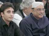Bilawal Bhutto Zardari (L), son of assassinated former Pakistani prime minister Benazir Bhutto, sits next to his father, Pakistan's President Asif Ali Zardari, during the fifth anniversary of his mother's death, at the Bhutto family mausoleum in Garhi Khuda Bakhsh, near Larkana December December 27, 2012.  PHOTO : REUTERS
