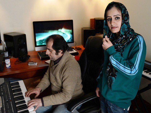 Soosan Feroz  practicing with Afghan pop musician Farid Rastagar at a recording studio in Kabul. PHOTO: AFP