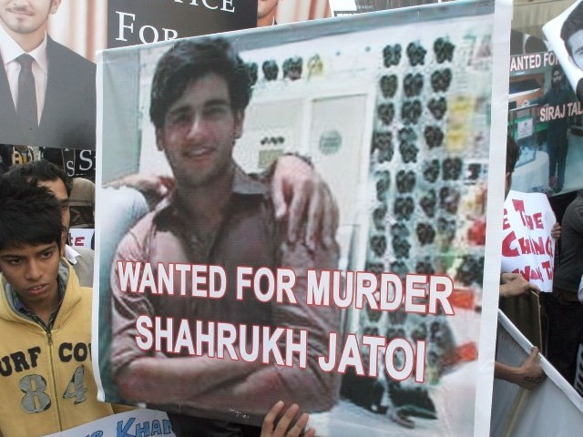 A file photo showing a placard bearing the alleged killer during a protest against the killing
