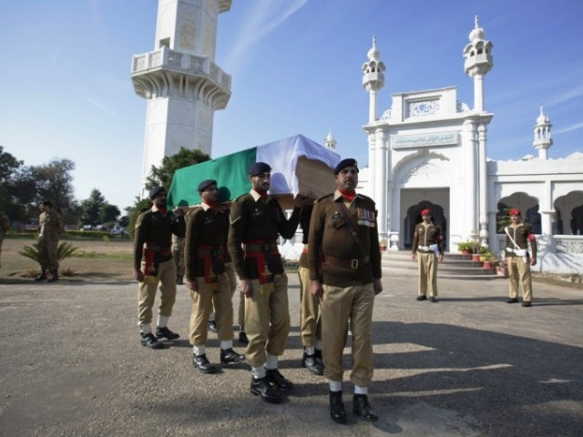 Soldiers carry the flag-draped casket of their colleague Havildar Ghulam Mohyuddin, whom the Pakistan military said was killed by Indian soldiers. PHOTO: REUTERS