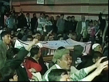 This television grab shows protesters chanting and raising slogans as they protest against the attacks on their community in Quetta on Friday. PHOTO: EXPRESS