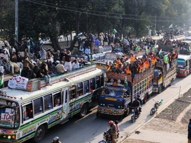 Supporters of Tahirul Qadri take part in a protest march in Lahore. PHOTO: AFP