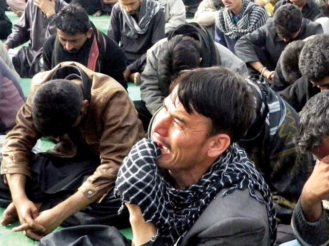 Protesters weep during a sit-in at Hyderabad bypass. Protests have erupted in several cities of Sindh to express solidarity with the families of victims of Quetta bomb blasts. PHOTO: ONLINE