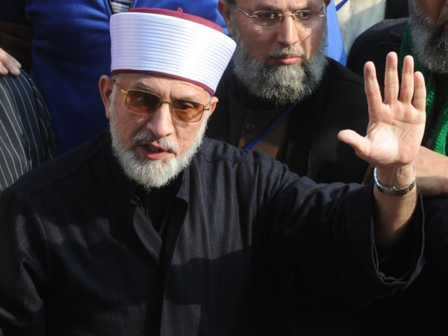 Tahirul Qadri talks with media representatives before the start of protest march in Lahore on January 13, 2013. PHOTO: AFP