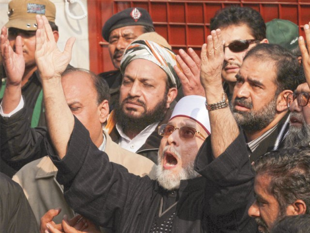 "Dr Tahirul Qadri prays in Lahore before leading his ""million-man march"".  PHOTO: MALIK SHAFIQ/EXPRESS"