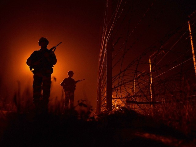 An Indian Border Security Force (BSF) soldiers patrols along the border fence at an outpost along the India-Pakistan border in Suchit-Garh, 36 kms southwest of Jammu on January 11, 2013. PHOTO: REUTERS/FILE