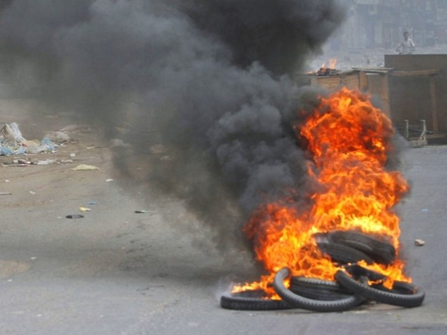 A file photo of burnt tyres during a protest in Karachi. PHOTO: REUTERS