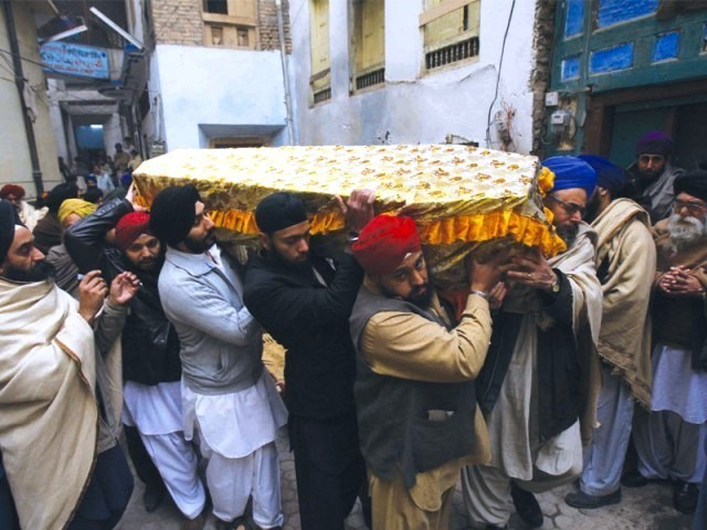 Pallbearers' carry Mahinder Singh's coffin, who was the father of six. He was kidnapped two months ago. PHOTO IQBAL MAMOUND/EXPRESS