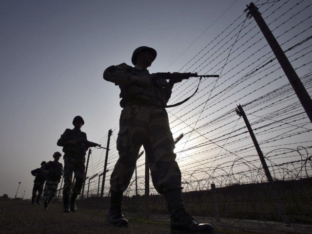 Indian Border Security Force (BSF) soldiers patrol the fenced border with Pakistan in Suchetgarh, southwest of Jammu January 16, 2013. PHOTO: REUTERS