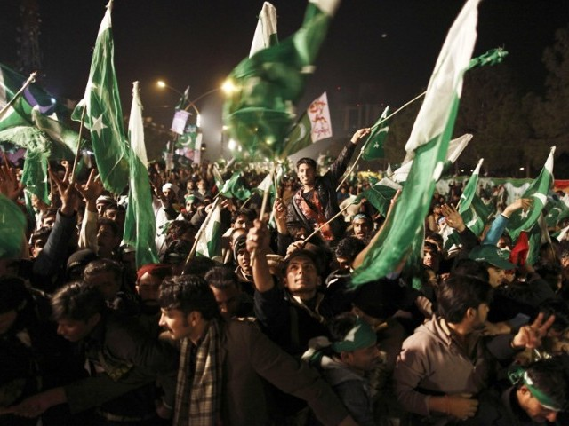 Supporters of Tahirul Qadri wave Pakistani flags during a protest in Islamabad. PHOTO: REUTERS /FILE