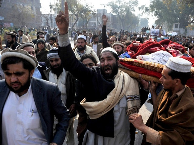 Bara tribesmen protest with bodies of those killed outisde the Governor House in Peshawar on January 16, 2013. PHOTO: AFP