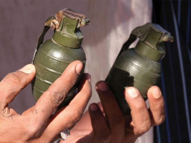 Police seized four hand grenades and other weapons from the suspects after engaging them in an encounter in Bilal Colony in Korangi on Friday. The suspects had created their own shadow militant group and used to extort money from traders in the area. PHOTO: ATHAR KHAN/EXPRESS