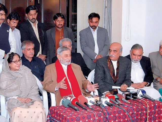 Raja Muhammad Afzal Khan with his two sons announcing their joining PPP during a news conference at the PPP media cell. PHOTO: APP