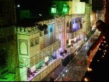 A devotee decorates a street to mark the celebration Eid Miladun Nabi in Lahore on January 24, 2013. PHOTO: AFP