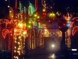 A motorist drives through an illuminated corridor in a bazaar in Lahore on Thursday. PHOTO: NNI