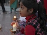 A child holds a candle while observing a global vigil for peace between India and Pakistan, in Karachi January 27, 2013. The vigil was organized by Joint Action Committee (JAC), an alliance of civil society organizations. PHOTO : REUTERS