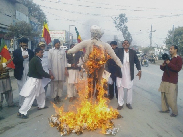 Protesters set on fire an effigy of Jamiat-e-Ulema Islam head Fazlur Rehman, dubbing him the main culprit.